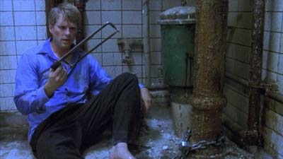 Film the saw dalam adegan guru yang harus memotong kaki dengan gergaji